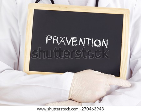 Doctor shows information: prevention in german - stock photo