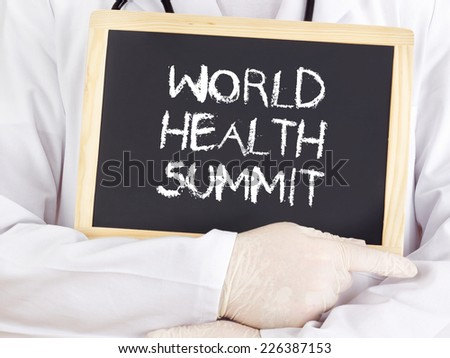 Doctor shows information: World Health Summit - stock photo