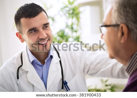 Doctor specialist and an Elderly Patient - stock photo