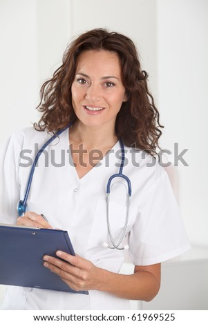 Doctor standing in hospital room - stock photo