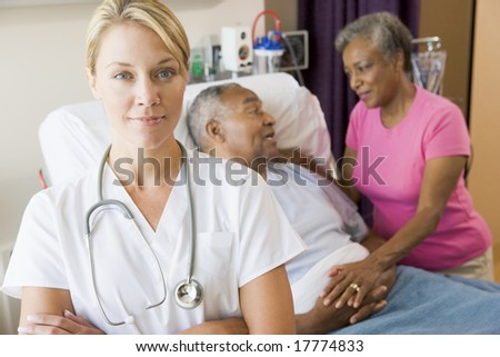 Doctor Standing In Hospital Room With Her Arms Folded - stock photo
