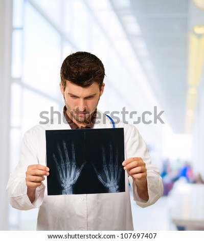 Doctor Studying Hand X-ray, Outdoor - stock photo