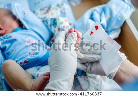 doctor takes a blood test in newborns. Extract from the hospital - stock photo