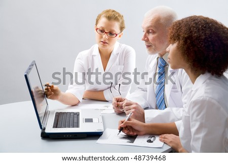 Doctor teaches a students - stock photo