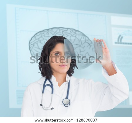 Doctor using a new technology in front of brain sketch - stock photo