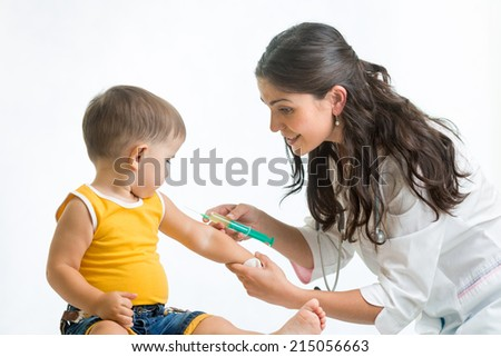 doctor vaccinating  child - stock photo