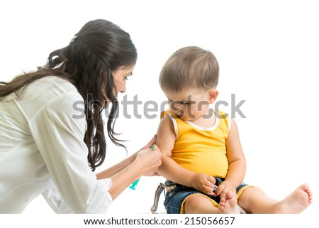doctor vaccinating  kid boy isolated - stock photo