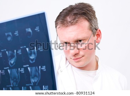 Doctor viewing MRI scans with isolated background - stock photo