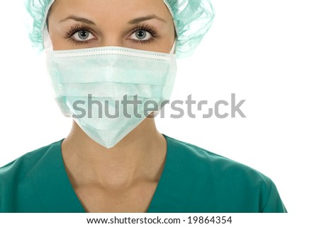 Doctor wearing a surgical mask and cap - stock photo