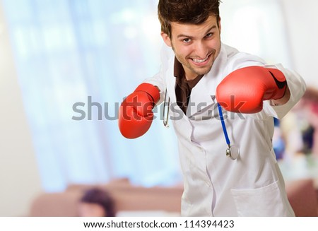 Doctor Wearing Boxing Gloves, Indoor - stock photo