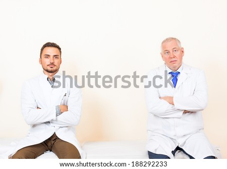 doctor white coat, folded hands, medical hospital collegues, sitting in office clinic - stock photo