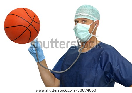 Doctor with a basket ball isolated in white - stock photo