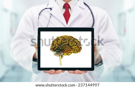 Doctor with brains in hands in a hospital - stock photo