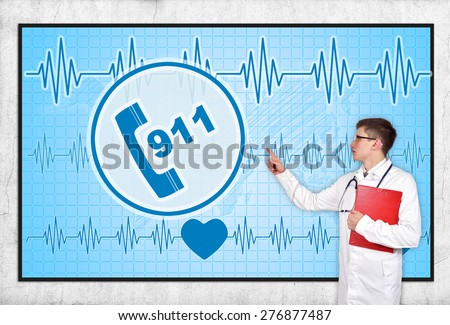 doctor with clipboard looking to screen with 911 symbol - stock photo