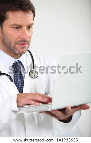 Doctor with computer - stock photo