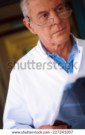 Doctor with glasses - stock photo
