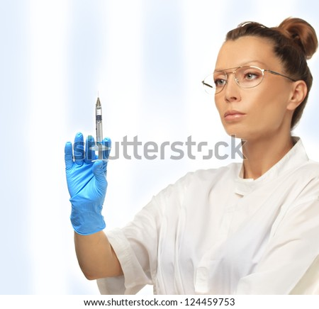 Doctor with glasses holding syringe for injection of beauty products. - stock photo