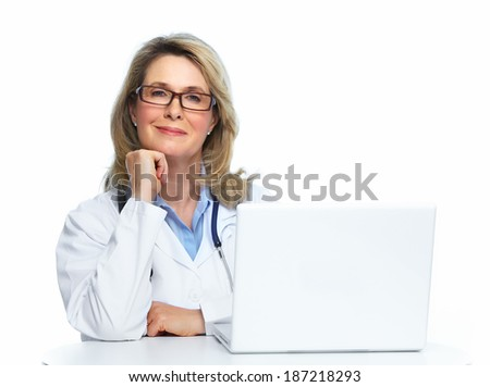 Doctor with laptop computer isolated on white background. - stock photo