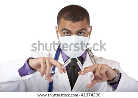 Doctor with mask holding a injection in his ands and looks into camera. Isolated on white. - stock photo
