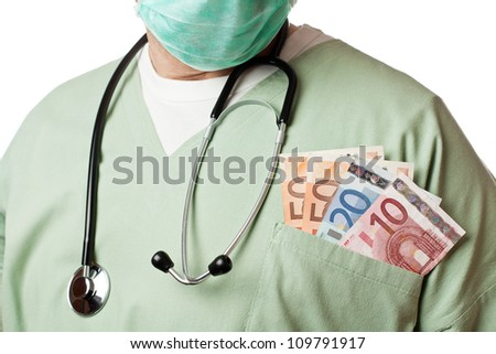 Doctor with money in his pocket. - stock photo