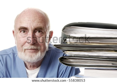 Doctor with pile of files - stock photo