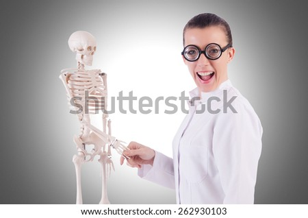 Doctor with skeleton on white - stock photo