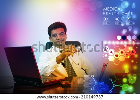 Doctor with stethoscope and laptop - stock photo