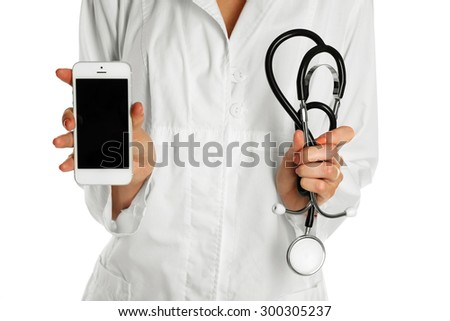 Doctor with stethoscope and smart phone, isolated on white - stock photo