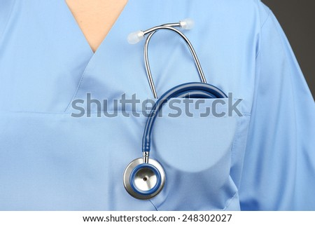 Doctor with stethoscope, close-up - stock photo