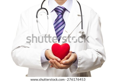 Doctor with stethoscope holding heart - stock photo