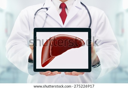 Doctor with stethoscope in a hospital. Liver on the tablet. High resolution.  - stock photo