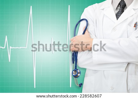 Doctor with stethoscope in hand and electrocardiogram on green background - stock photo