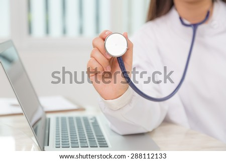 Doctor with stethoscope in the hands - stock photo