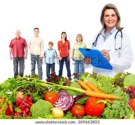 Doctor with vegetables and family. Healthy diet and nutrition. - stock photo