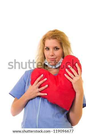 Doctor (woman) with big heart - stock photo