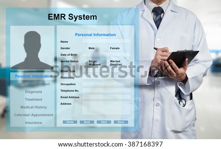 Doctor working with EMR - Electronic Medical Record system - stock photo