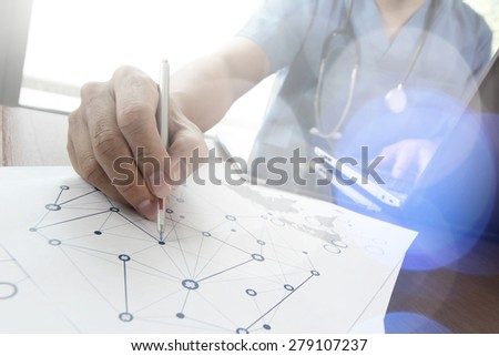 Doctor working with  laptop computer in medical workspace office and medical network media diagram as concept - stock photo
