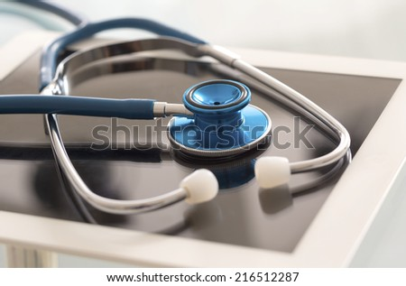Doctor workplace with digital tablet and stethoscope - stock photo