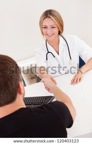 Doctor writing down prescription for sick client. - stock photo