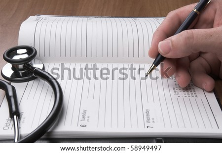 Doctor writing in diary - stock photo