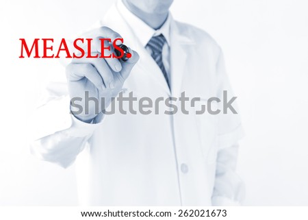 Doctor writing measles word on  virtual screen - stock photo