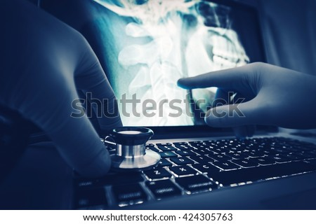 Doctor Xray Imagery Examination on the Laptop Computer.