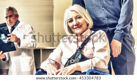 Doctors and patients in hospital room. - stock photo