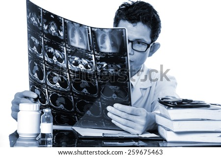 Doctors are viewing film X-ray of the patient,Concept medicine  (shallow depth of field) - stock photo