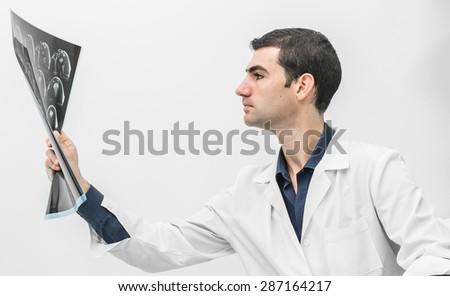 doctors examining an x-ray - stock photo