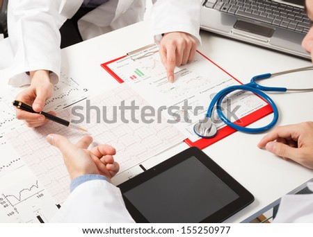 Doctors examining medical tests - stock photo