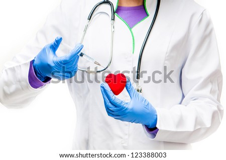 Doctors hands with Syringe and red heart on a white background - stock photo