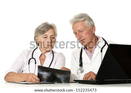 Doctors in a white coat with a stethoscope exemining x-ray - stock photo