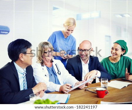 Doctors in Meeting At Hospital - stock photo