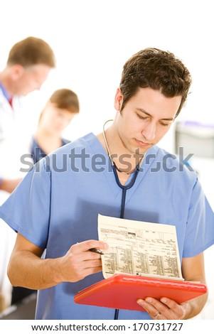 Doctors: Male Nurse Reviews Lab Tests - stock photo